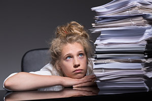 wordker overwhelmed by paperwork